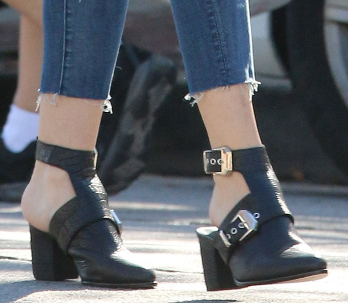 Jaime King shows off her feet in black buckled booties