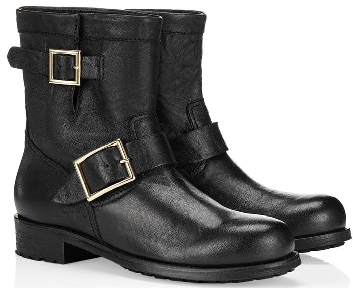 Two gleaming buckles detail a stacked-heel boot inspired by classic motorcycle style