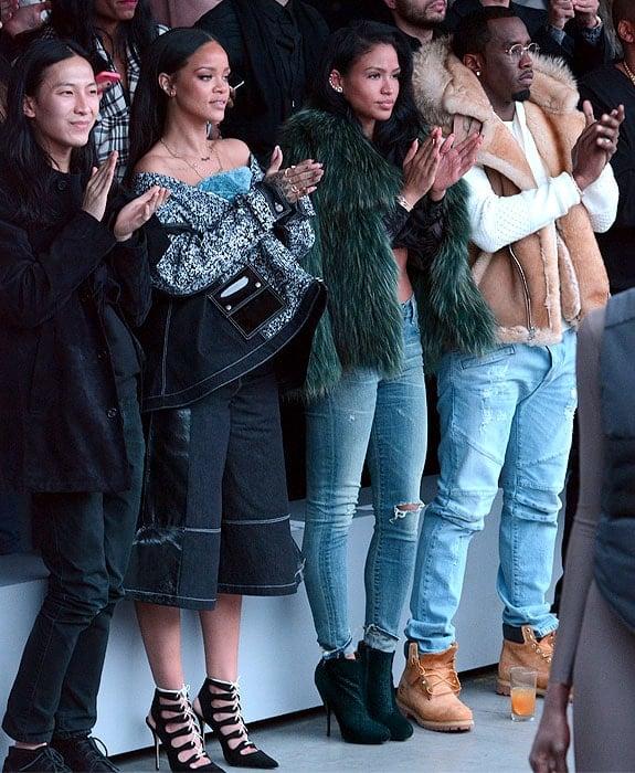 Alexander Wang, Rihanna, Cassie, and P. Diddy giving a standing ovation