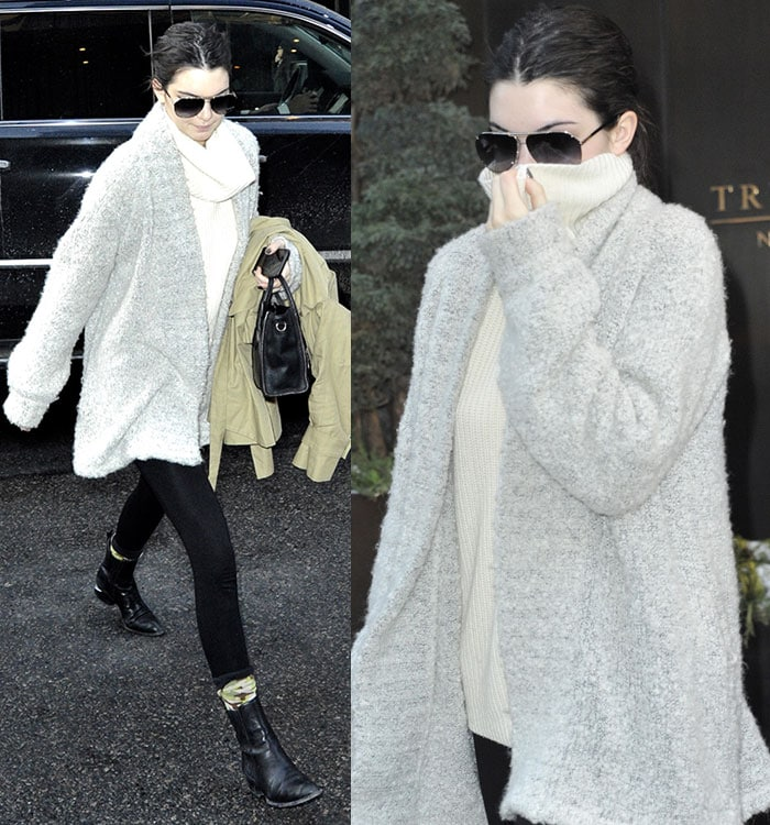 Kendall Jenner in a cream high-neck sweater top and fitted pants