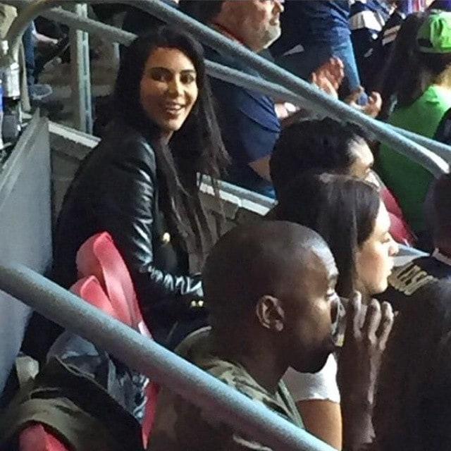 Kim Kardashian and Kanye West appear in a photo taken by a fan