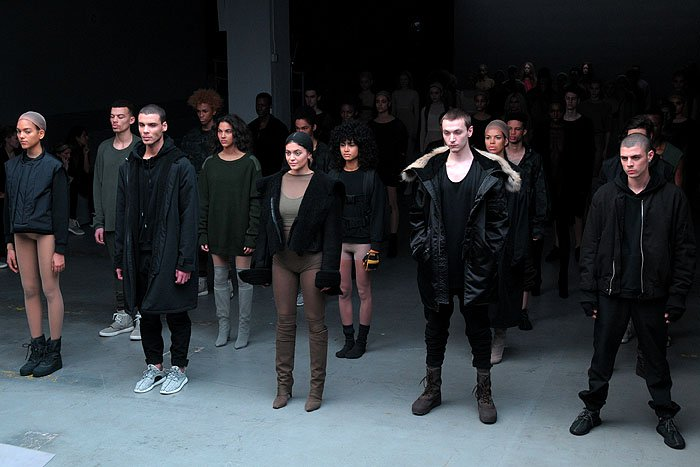 Kylie Jenner standing with other models at the Adidas Originals x Kanye West Yeezy fashion show
