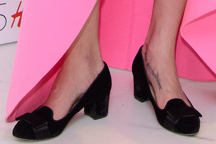 Lily Cole's feet in Valentino black velvet loafer pumps with black satin bows and low block heels