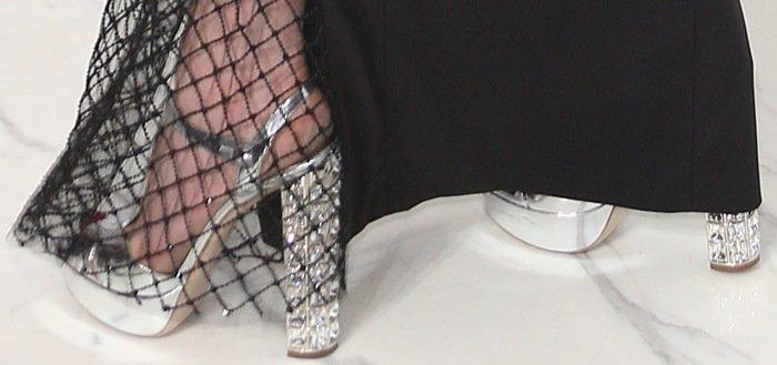 Lindsay Lohan shows off her feet inMiu Miu platform sandals