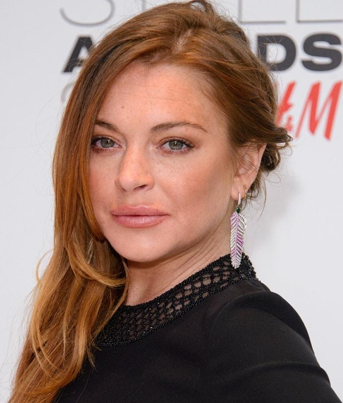 Lindsay Lohan shows off herCrow's Nest earrings