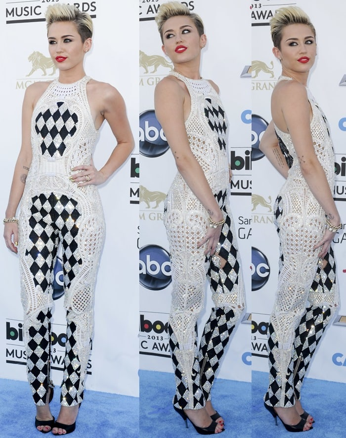 Miley Cyrus rocks a Balmain jumpsuit and Givenchy shoes on the blue carpet at the 2013 Billboard Music Awards held at the MGM Grand Garden Arena in Las Vegas on May 19, 2013