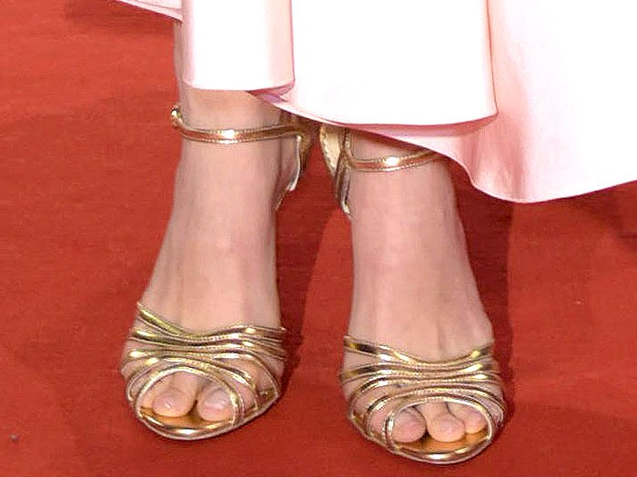 "Natalie Portman's hot feet in Charlotte Olympia gold ""Gilda"" sandals"