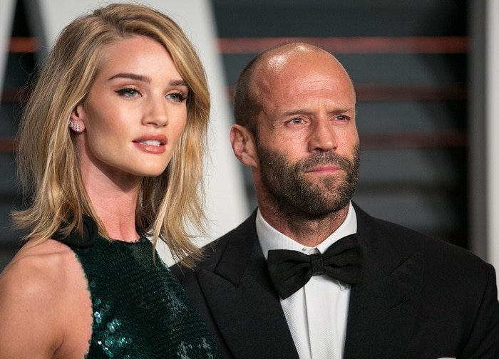 Jason Statham wrapped his arm around Rosie Huntington-Whiteley at the 2015 Vanity Fair Oscar Party held during the 2015 Oscars in Beverly Hills on February 22, 2015