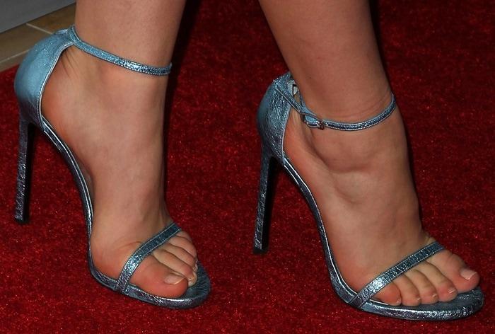 Kiernan Shipka's blue foil Stuart Weitzman Nudist ankle-strap sandals