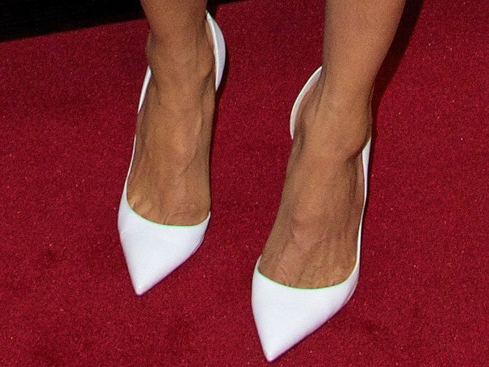 Thandie Newton's hot feet in Christian Louboutin white d'Orsay pointy-toe pumps