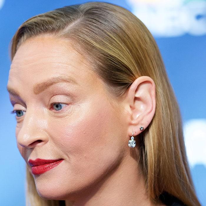 Uma Thurman wearing Chopard earrings
