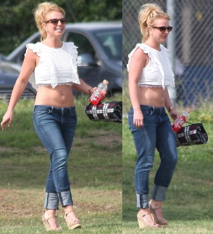 Britney Spears showed off her abs in a white crop top and blue jeans