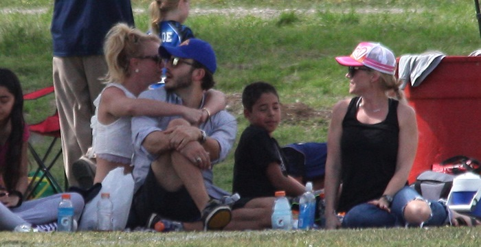 Britney Spears spent a romantic day out holding hands and cuddling up with her boyfriend, Charlie Ebersol, as they watched her sons play soccer in Los Angeles on March 15, 2015