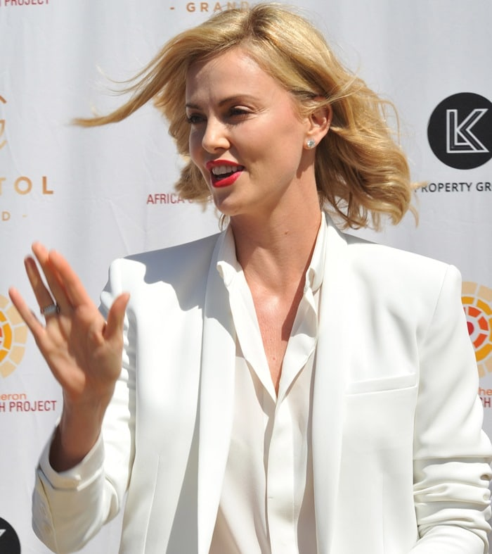 Charlize Theron in a crisp white blazer from the Barbara Bui Spring 2015 collection