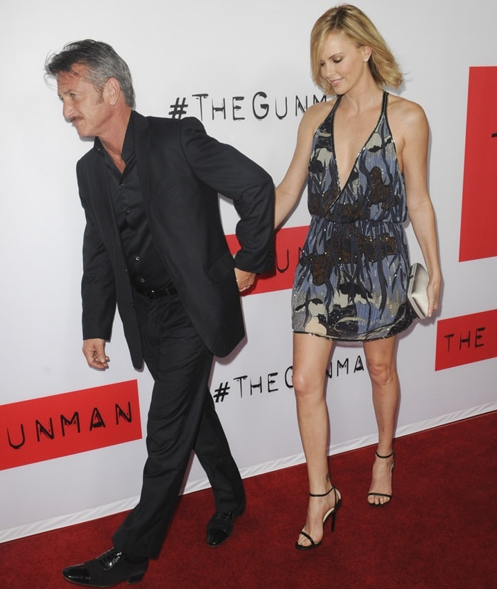Charlize Theron paraded her legs at The Gunman premiere in a blue printed bohemian dress