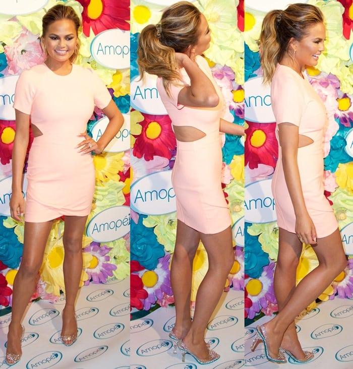 Chrissy Teigen paraded her legs in a tight peach mini dress