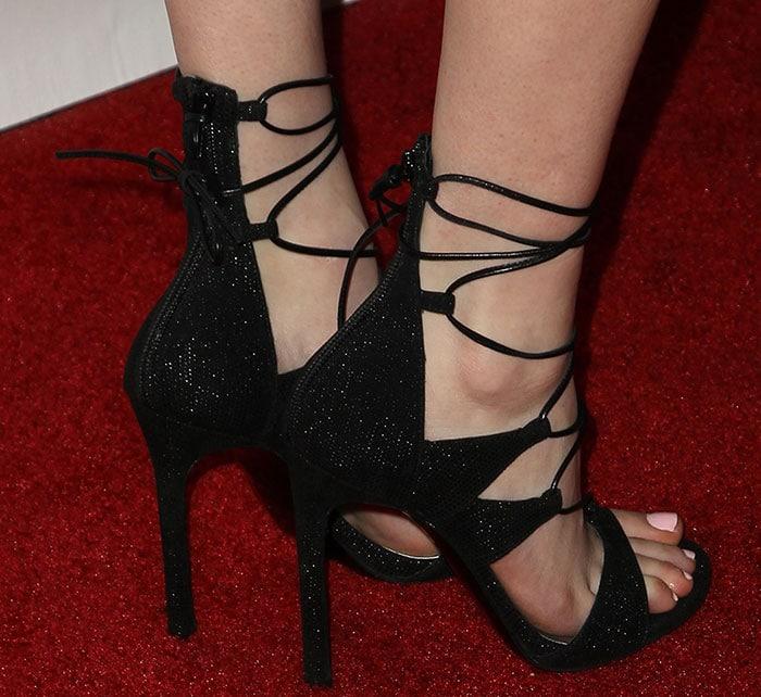 Emma Roberts's hot feet in Stuart Weitzman sandals