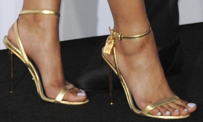 Eniko Parrish wearing metallic ankle-lock sandals from Tom Ford