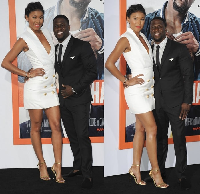 Eniko Parrish in a white tailored silk-blend dress from Balmain featuring the label's engraved gold-tone buttons