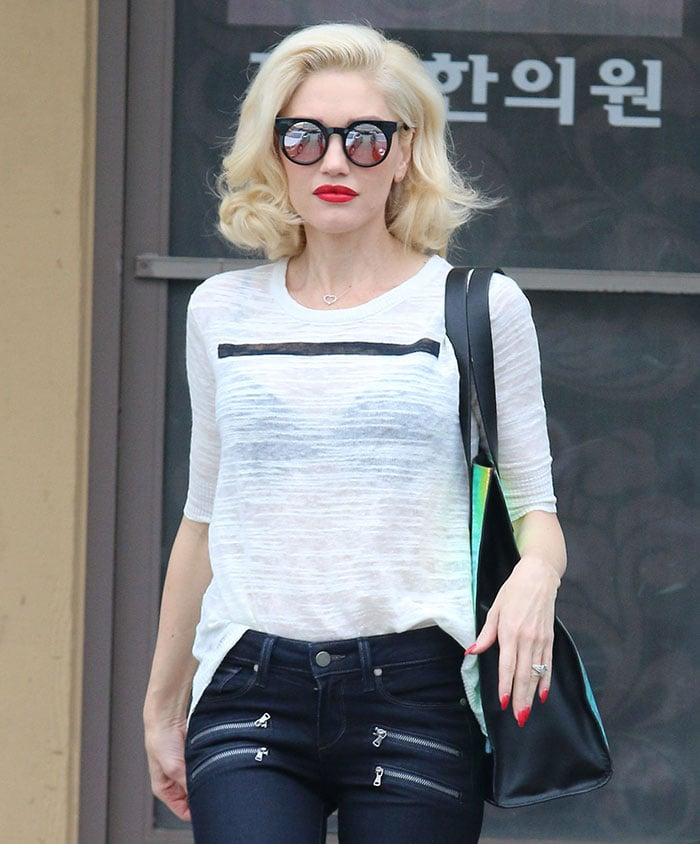 Gwen Stefani's jeans with silver-tone zippers
