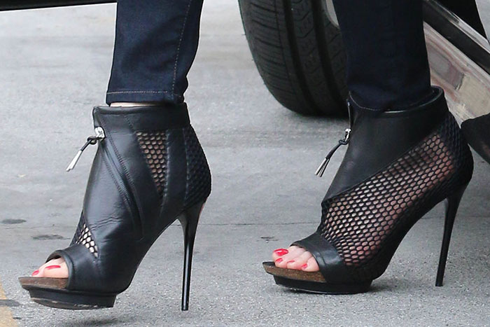 Gwen Stefani's boots made of mesh and leather with asymmetrical zippers