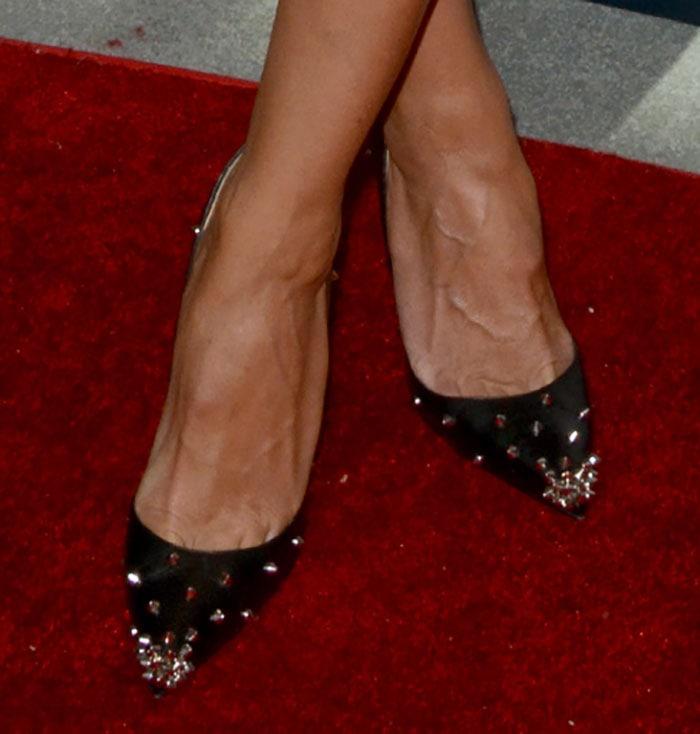 Heidi Klum puts her feet on display in black studded pumps