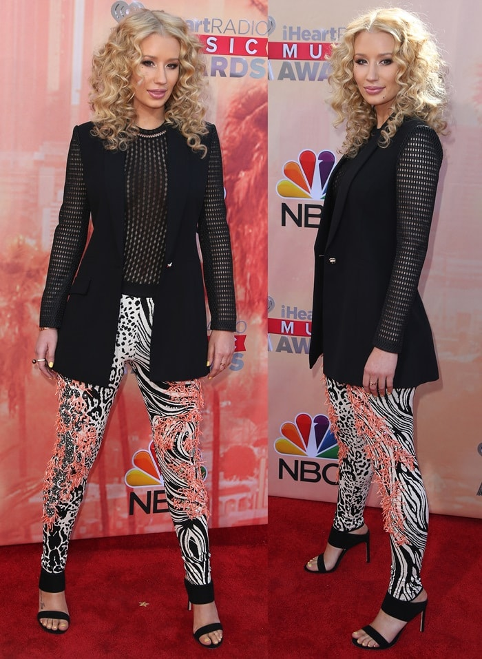 Iggy Azalea rocked curls in her hair on the red carpet at the 2015 iHeartRadio Music Awards held at the Shrine Auditorium in Los Angeles on March 29, 2015