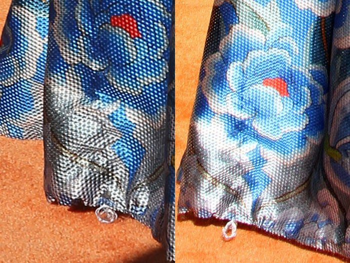 A snagged thread pulled from the hem of Iggy Azalea's skirt
