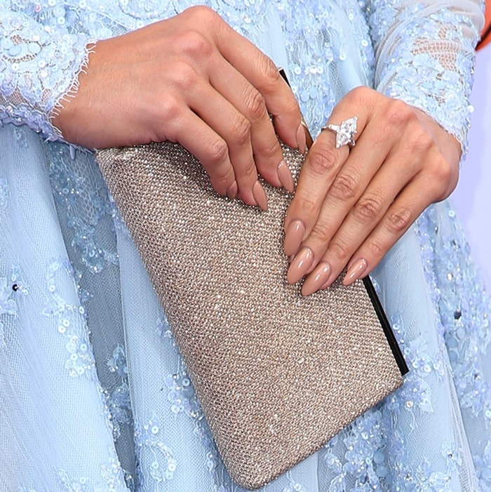 Jennifer Lopez showing off her rings and a stunning clutch