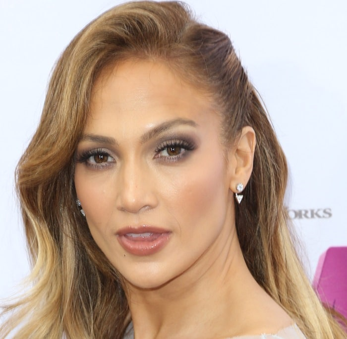 Jennifer Lopez attended the premiere of her new film 'Home' held at the Regency Village Theatre