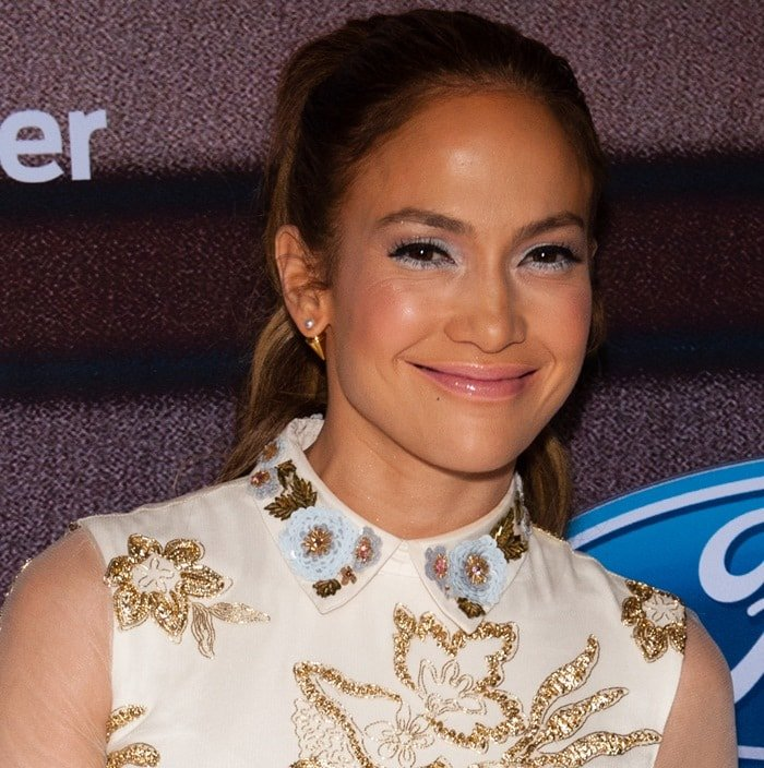 Jennifer Lopez wears her hair back at the American Idol XIV Top Finalists Party