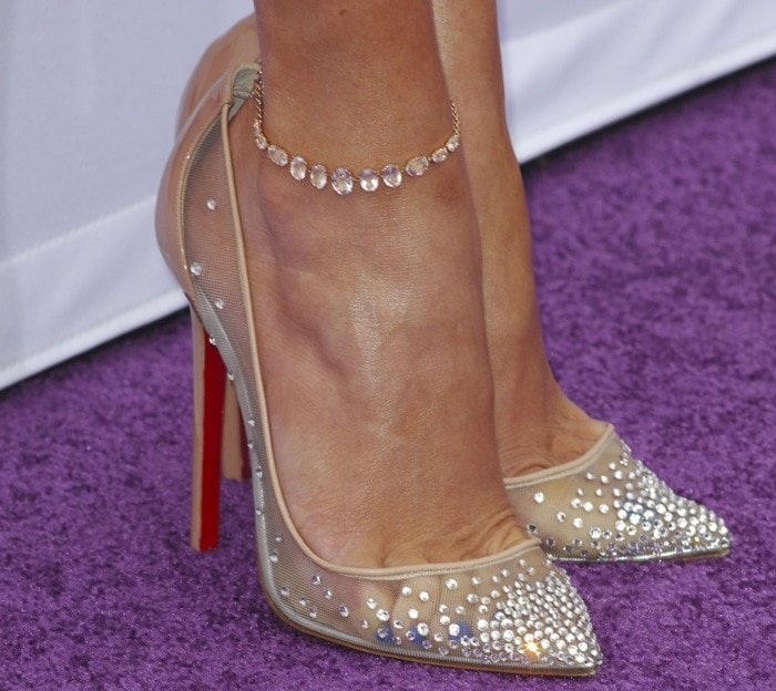 Jennifer Lopez completed the ensemble with a gorgeous pair of crystal-embellished pumps from Christian Louboutin