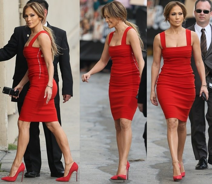 Jennifer Lopez paraded her legs in a red stretch-crepe dress with asymmetrically wrapped bands