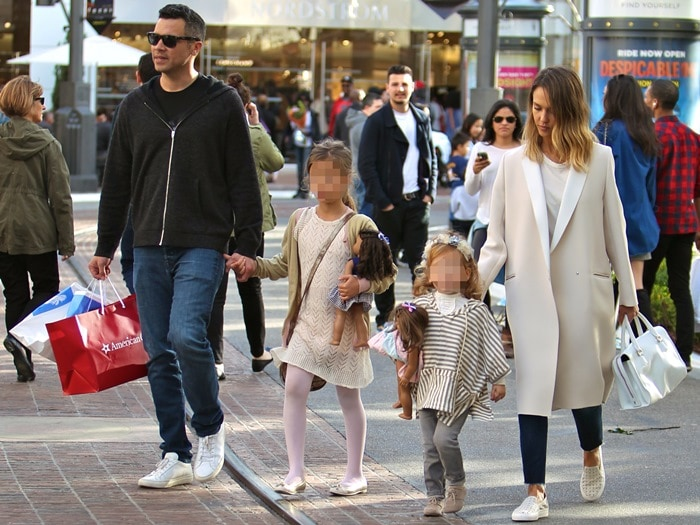 Jessica Alba and husband Cash Warren take their daughters shopping at The Grove in Los Angeles, and they stop by the American Girl Place store, where they bought their daughters some dolls on February 28, 2015