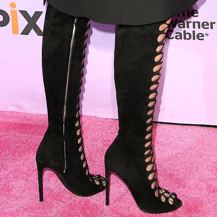 Side view of Katy Perry's Giambattista Valli black suede lace-up boots