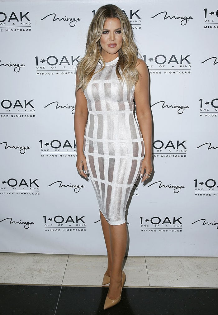Khloe Kardashian squeezed herself into the shimmering bodycon frock