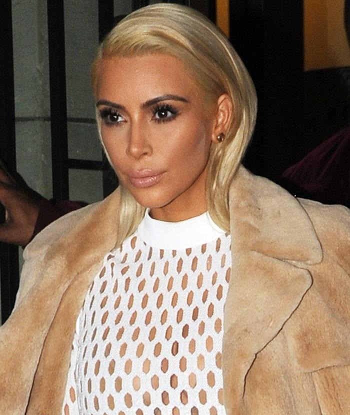 Kim Kardashian cream fishnet dress