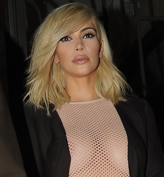 Braless Kim Kardashian exposed her nipples in pink mesh dress paired with a black cut-out jacket