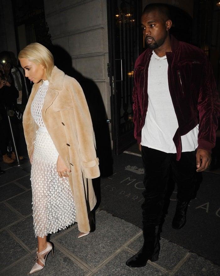 Kim Kardashian styled her mesh white midi dress with a teddy-style fur coat