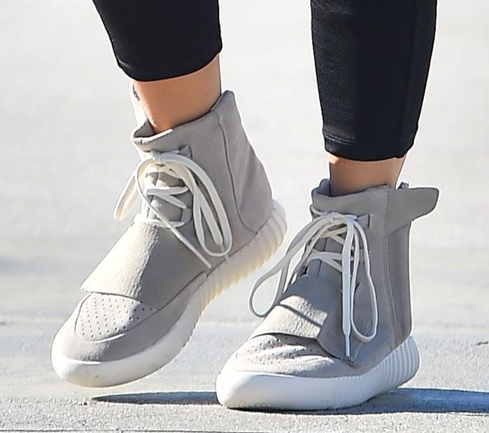Kim Kardashian wearing Kanye West x adidas Yeezy 750 Boost sneakers