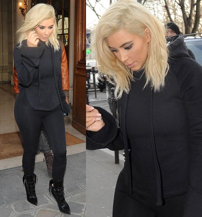 Kim-Kardashian-wears-hoodie-and-boots-in-paris