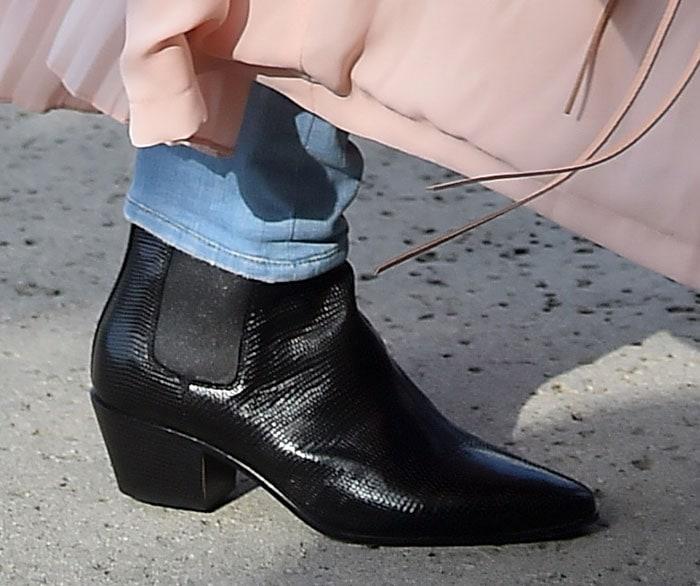 Kourtney Kardashian wearing Saint Laurent boots