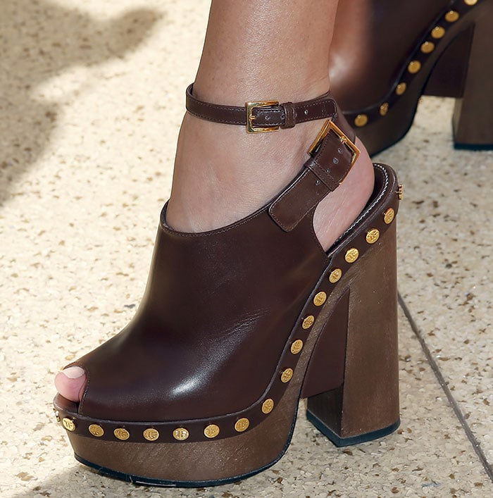 Kourtney Kardashian in towering clogs from one of her favorite designers, Tom Ford