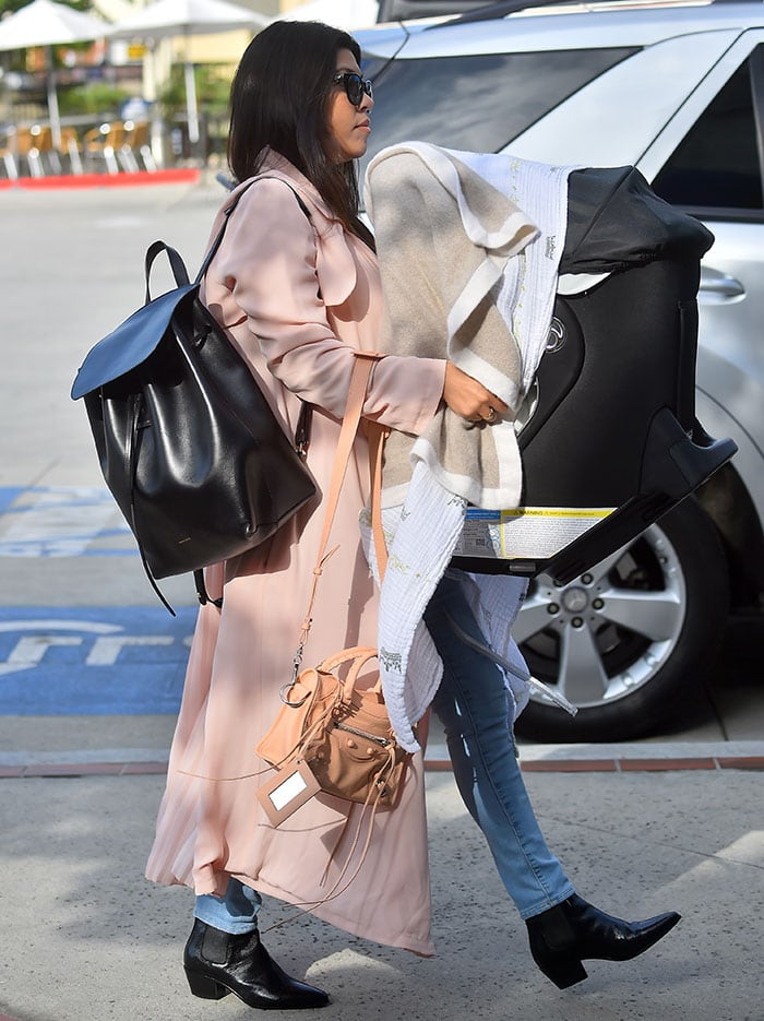 Kourtney Kardashian's affordable pink First & I trench coat