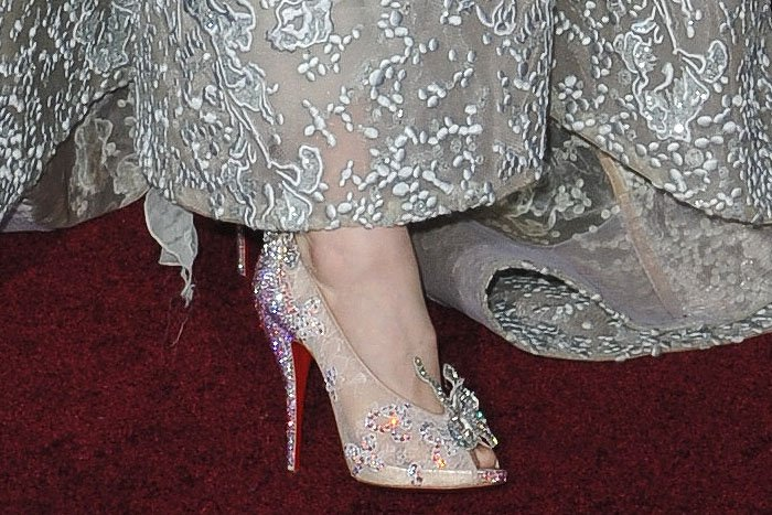 "Closeup of  Lily James' Christian Louboutin and Disney ""Cinderella"" crystal-embellished lace peep-toe pumps"
