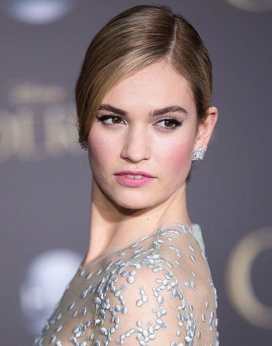 Lily James wearing Kwiat diamond earrings