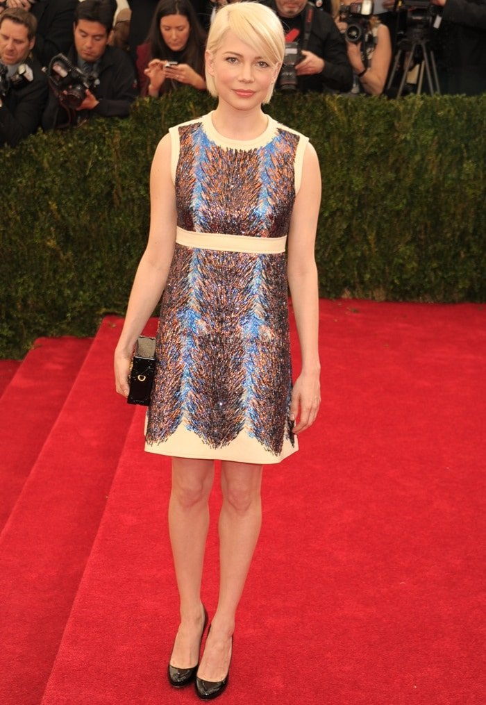 Michelle Williams flaunted her legs in a shimmering Louis Vuitton dress