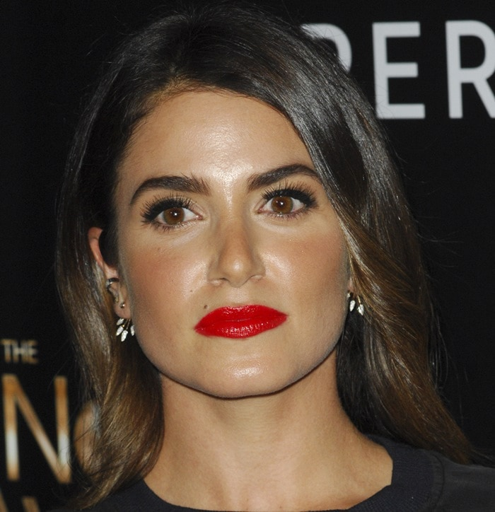 Nikki Reed wears her dark hair down at the 2015 Noble Awards