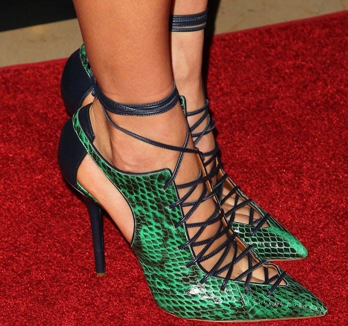 "Nikki Reed's feet in green snake-print ""Montana"" pumps"