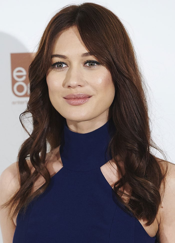 Olga Kurylenko looked every inch a supermodel in a form-fitting blue halter-neck dress
